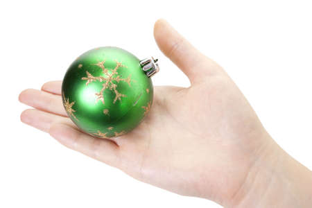 Hand and christmas toy decoration isolated on white background Stock Photo