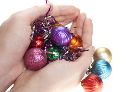 Hand and christmas toys decoration isolated on white background photo