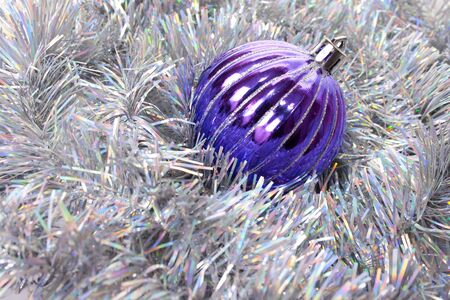 New-year decorations. Christmas ball and tinsel  background. Stock Photo