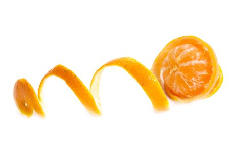 Tropical fruit. Tangerine with the taken off skin on a white background photo