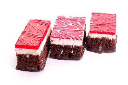 Slices of chocolate cake covered in different colored jelly