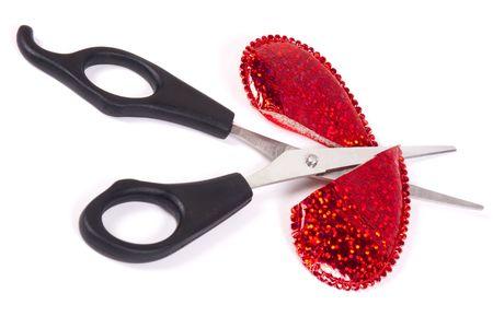 Scissors cut a red heart