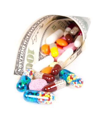 Pills, capsules and US cone dollars on a white background Stock Photo - 6679873