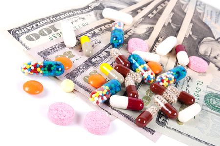 Pills, capsules and US dollars on a white background