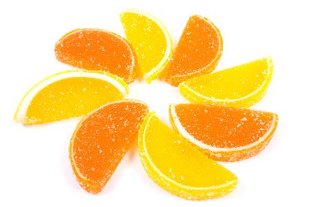 Flower of fruit jellies. Jelly candies citrus in form lobules isolated on a white background Stock Photo - 6996588