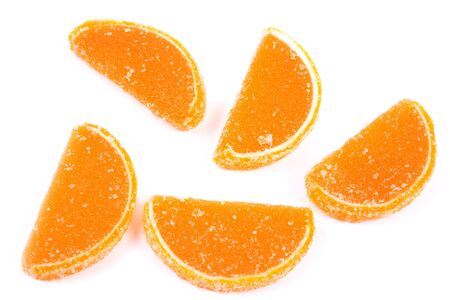 Fruit jellies. Jelly candies citrus in form lobules isolated on a white background Stock Photo