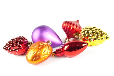 Christmas and new-year decorations. Varicoloured christmas toys on white background photo
