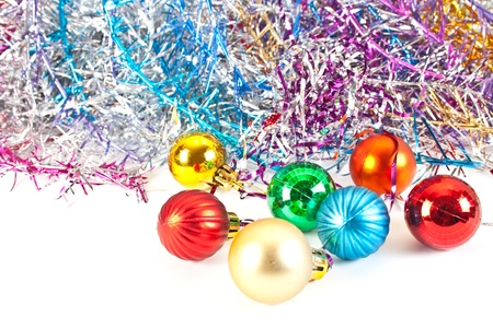 Christmas and new-year decorations. Christmas balls and varicoloured tinsel isolated on white background  photo