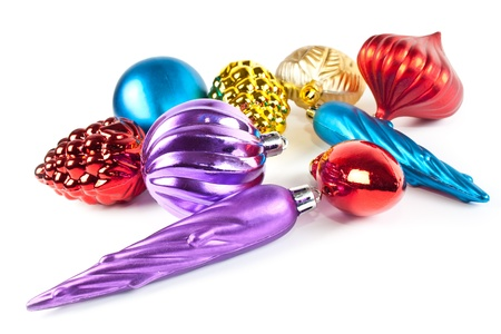 Christmas and new-year decorations. Varicoloured christmas toys and balls on white background photo