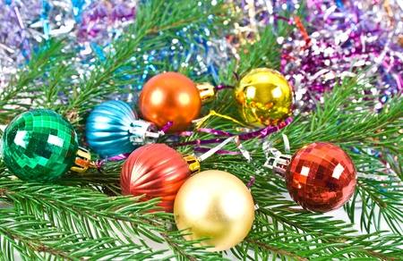Christmas and new-year decorations. Fir tree branch with decoration on a tinsel background.  photo