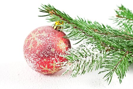 Christmas and new-year decorations. Fir tree snow branch with decoration on a white background photo