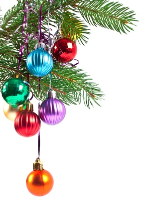 Christmas and new-year decorations. Fir tree branch with decoration on a white background