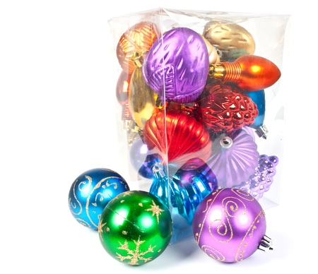 Christmas and new-year decorations. Varicoloured christmas balls in a box, on white background. photo