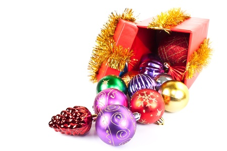 christmas present. Gift box and christmas baubles on a white background photo