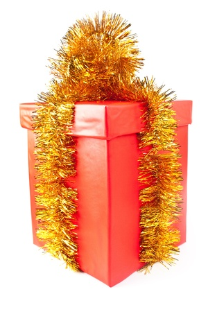 Red Gift Box decoration on a tinsel on white background  photo