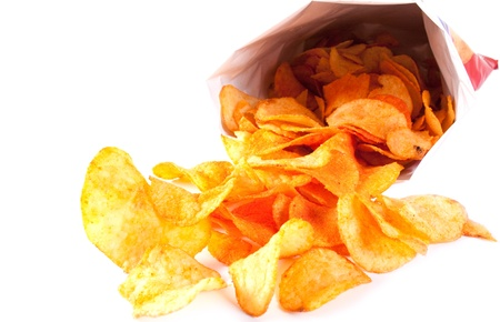 potato chip: Bag of fried Potato Chips. Potato chips poured out from packing on a white background Stock Photo