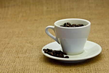 arrangement of coffee beans and coffee cup  photo