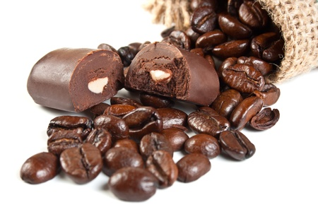 sac: chocolate candies and coffee beans in a linen sac isolated on white background