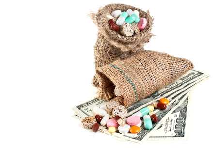 sac: Medical tablets, pills and vitamins in a linen sac and money isolated on a white background  Stock Photo
