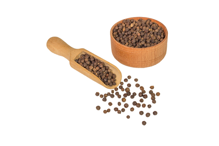 pungency: allspice in a wooden bowl. Black pepper. Spice. isolated on white background.