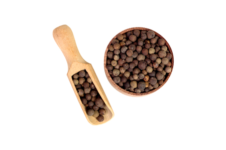 allspice in a wooden bowl. Black pepper. Spice. isolated on white background.