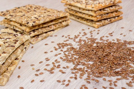 Flax biscuit. Healthy snacks, flaxseed pumpkin seeds, coriander, sunflower seeds. Salted diets are crispy crackers. Whole meal.