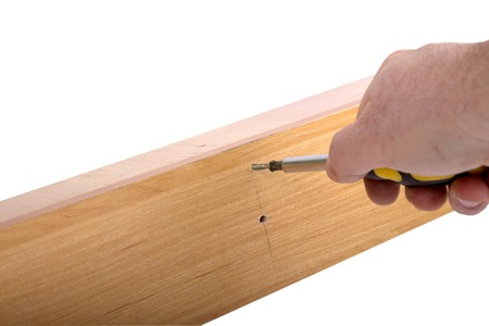 Self-assembly furniture, the hand with an Allen key tighten the screw.
