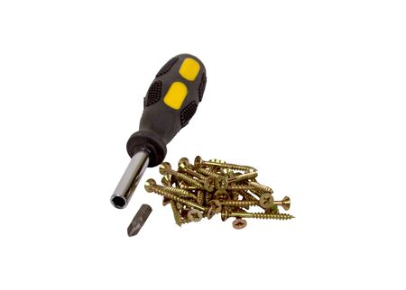 Screws and screwdriver isolated on white background.