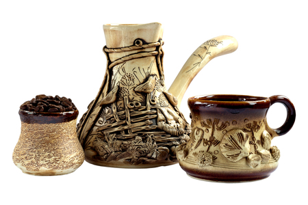 Ceramic coffee set, cezve and cup with coffee. Stock Photo