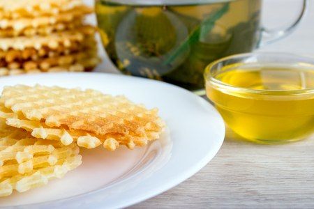 waffles with honey and cup of tea. Stock Photo
