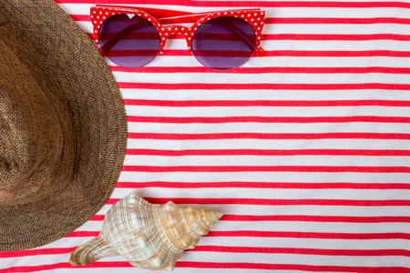 Straw Beach Womans Hat Sun Glasses Top View Seashell with space for text. Stock Photo