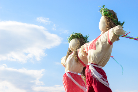 Closeup scarecrow in countryside of Ukraine. Scarecrow against the sky Stock Photo