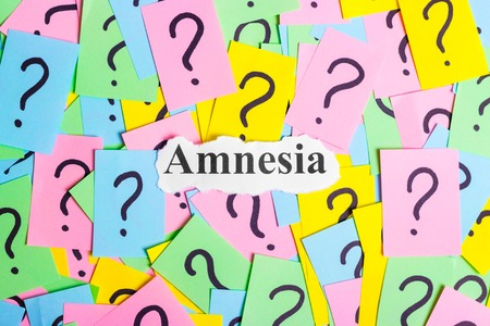 paper sheet: amnesia Syndrome text on colorful sticky notes Against the background of question marks Stock Photo