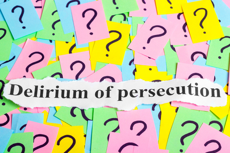 ibs: Delirium of persecution text on colorful sticky notes Against the background of question marks