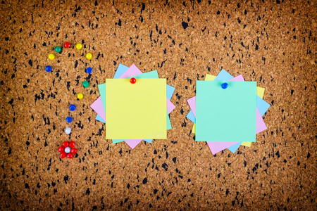pin board: colorful sticky notes on cork bulletin board. Question mark made of pushpins Stock Photo