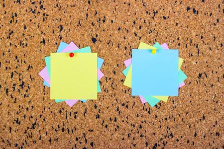 colorful sticky notes on cork bulletin board Stock Photo