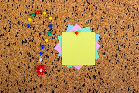 pinning: colorful sticky notes on cork bulletin board. Question mark made of pushpins Stock Photo