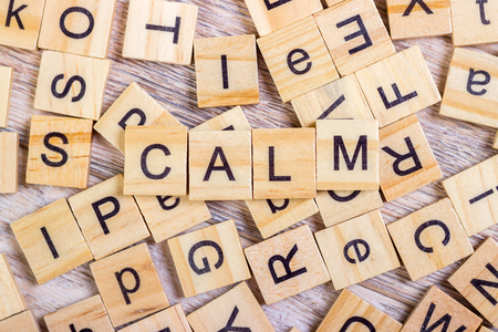 dispassionate: calm - cube with letters, sign with wooden cubes Stock Photo
