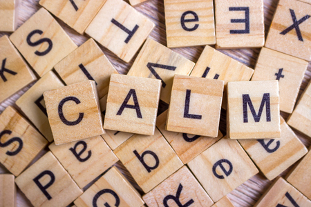 calm - cube with letters, sign with wooden cubes Stock Photo