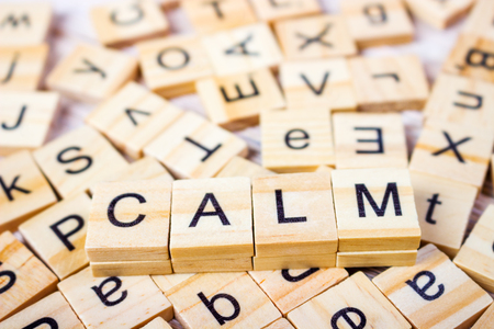 imperturbable: calm Word on Background of cubes with letters. Sign with wooden cubes Stock Photo