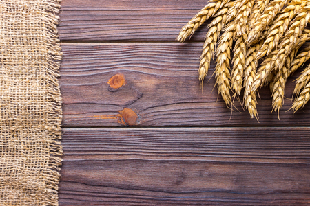 wheat grains on wooden plank background Harvest concept Stock Photo