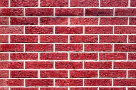 Background of red brick wall with peeling plaster texture Stock Photo