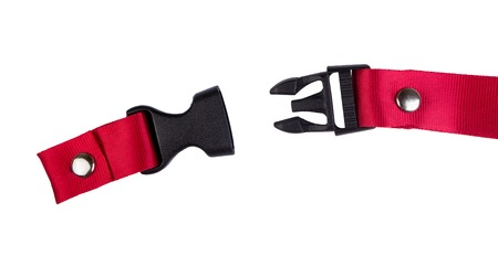 un used: Side release buckle from plastic with Red belt nylon on the white background.