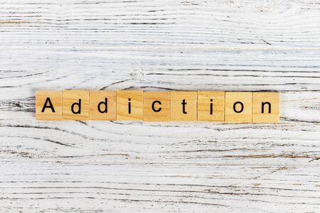ADDICTION word made with wooden blocks concept