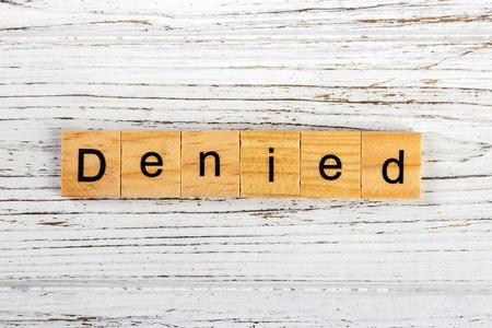 seal of approval: DENIED word made with wooden blocks concept
