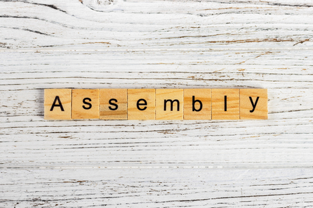 ASSEMBLY word made with wooden blocks concept Stock Photo
