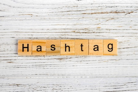 marketing online: HASHTAG word made with wooden blocks concept