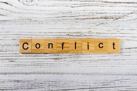 CONFLICT word made with wooden blocks concept Stok Fotoğraf