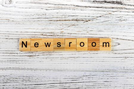 NEWSROOM word made with wooden blocks concept Stock Photo - 85880616