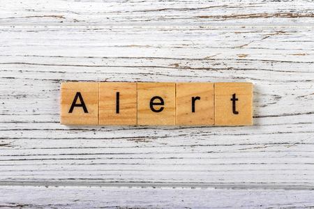ALERT word made with wooden blocks concept Stock Photo